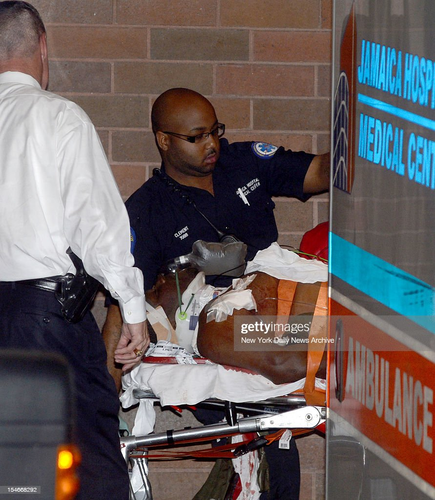 Police officer shooting suspect Darrell Fuller, who allegedly gunned down a Nassau County cop Tuesday morning and then a random stranger in a highway carjacking in Queens, is taken into Jamaica Hospital after suffering a gunshot wound this afternoon.