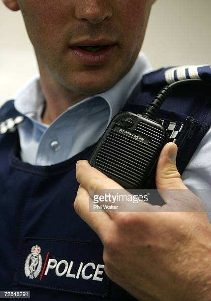 A police officer speaks into his radio as he models the Stab Resistant Body Armour that is being handed out to the New Zealand Police Force December...