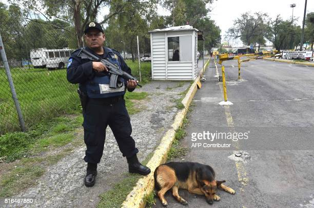 Police officer stand guard outside the 'Reclusorio Norte' prison on July 17 2017 in Mexico City where former governor Javier Duarte is awaited...