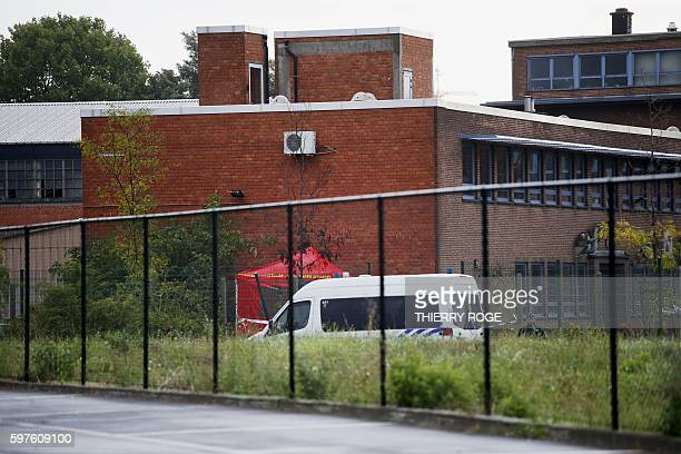 A police officer stand guards the National Institute for Criminalistics and Criminology to inspect the site of an explosion that happened early on...