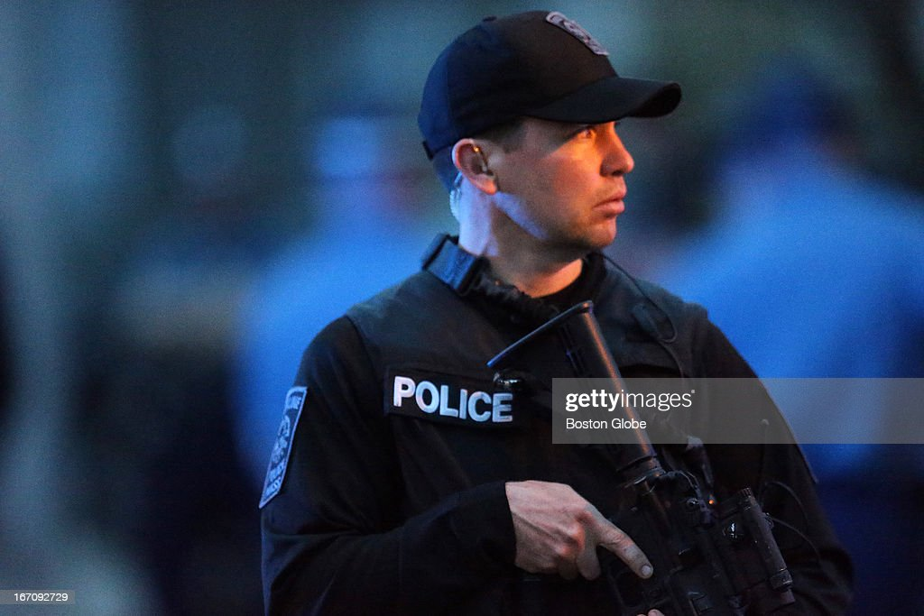 A police officer stands at the intersection of Franklin and Mount Auburn Streets where the second suspect was captured After an intense manhunt and...