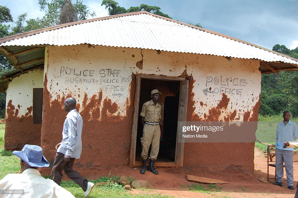 DISTRICT, UGANDA - (Not for sale to The Star (Kenya), Capital FM, The People, Citizen TV, Kenya Broadcasting Corporation) A police officer stands by the doorway of Busamuzi police post in Bavuma District, Uganda. Police posts and station in Uganda are in a very deplorable state.