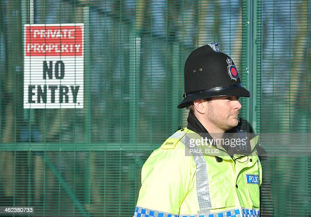 A police officer stands guard at the gates to a site where energy company IGas has permission to carry out exploratory drilling for shale gas at...