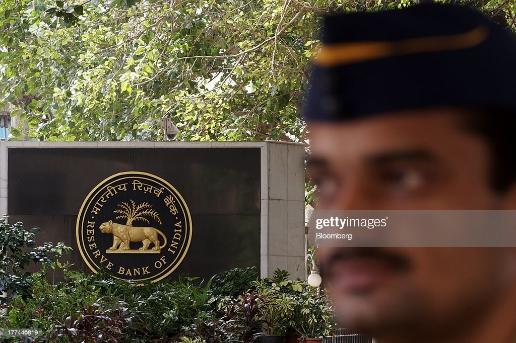 A police officer stands guard at the Reserve Bank of India headquarters in Mumbai India on Friday Aug 23 2013 Indias rupee plunged 44 percent to a...