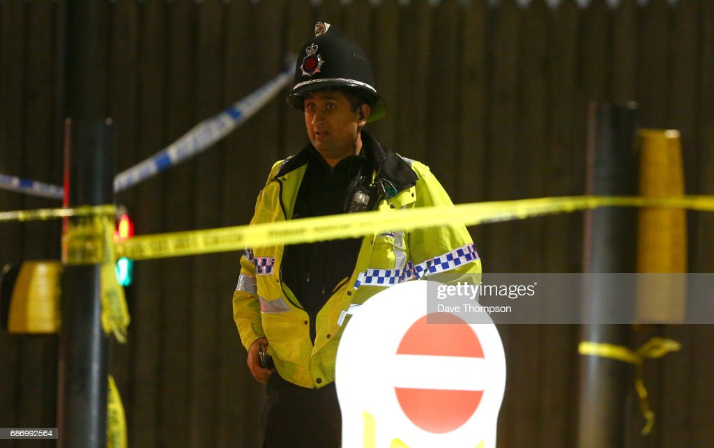 MANCHESTER, ENGLAND - A police officer stands guard close to the Manchester Arena on May 23, 2017 in Manchester, England. There have been reports of explosions at Manchester Arena where Ariana Grande had performed this evening. Greater Manchester Police have have confirmed there are fatalities and warned people to stay away from the area.