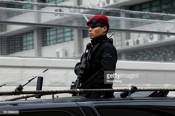 A police officer stands guard in a vehicle patroling around the US Embassy in Seoul South Korea on Tuesday Feb 12 2013 North Korea conducted its...