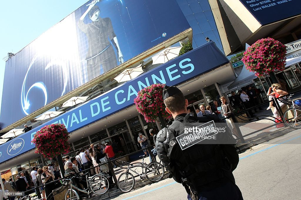 A police officer stands guard in front of the Palais des Festivals as a demonstration against the film 'Outside Of The Law' by French-Algerian director Rachid Bouchareb, whom they accuse of distorting history, took place on the sidelines of the 63rd Cannes Film Festival on May 21, 2010 in Cannes. Opening with a massacre of Algerian civilians by French soldiers in the town of Setif in 1945 -- a controversial historical event which some critics say has been misrepresented -- the film is one of very few cinematic treatments of the conflict.