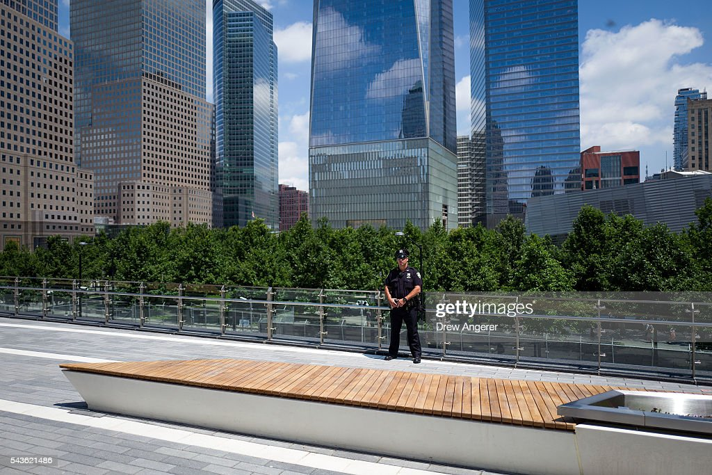 A police officer stands guard in the newly opened Liberty Park in Lower Manhattan, June 29, 2016 in New York City. Liberty Park, elevated above Liberty Street in Lower Manhattan, overlooks the National September 11 Memorial Plaza and One World Trade Center. The one-acre, $50 million park will be open to the public every day from 6 in the morning to 11 at night.