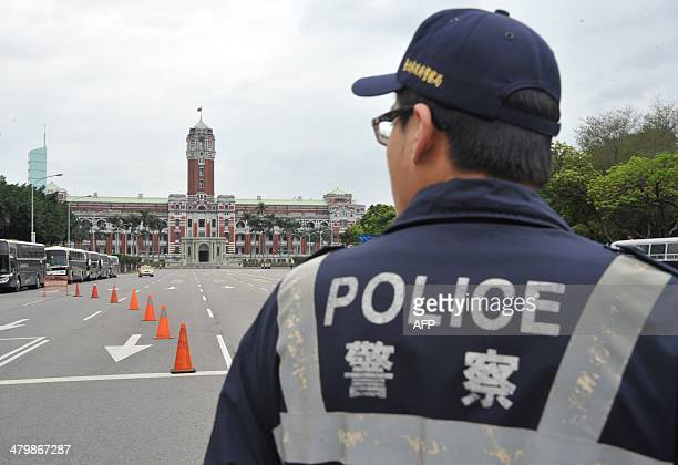 A police officer stands guard near placed in front of the Presidential Palace in Taipei on March 21 2014 Student protesters occupying Taiwan's...