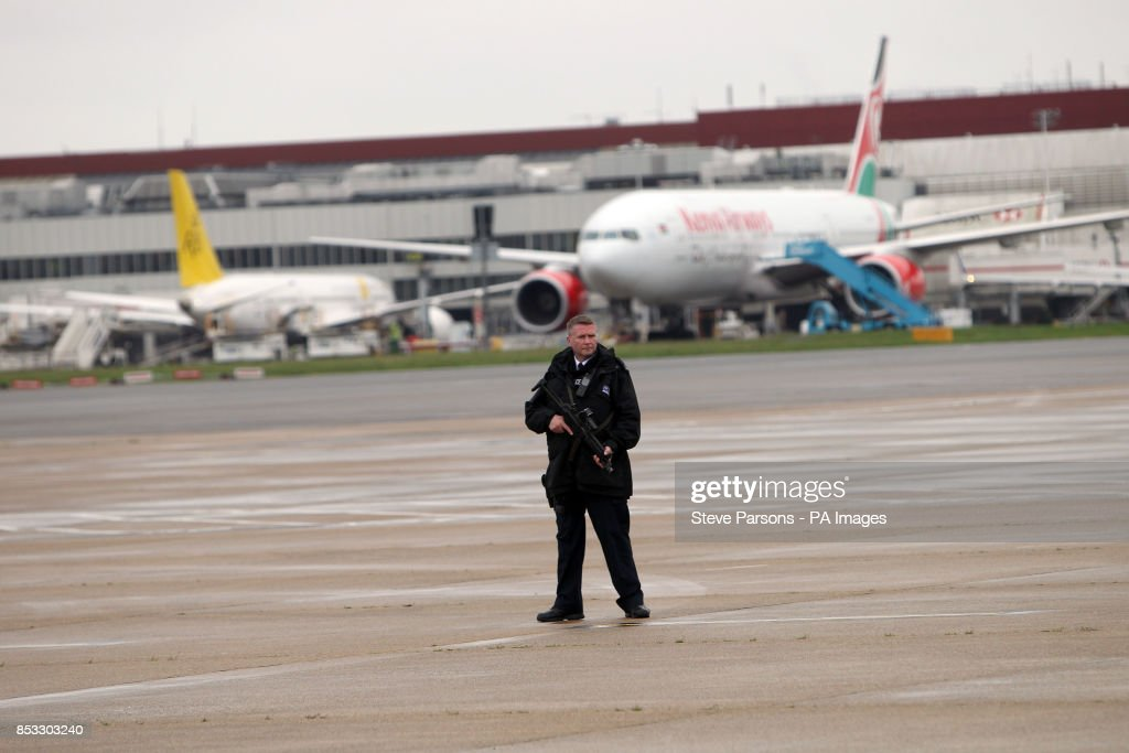 A Police Officer Stands Guard Near The Royal Suite At Heathrow Airport