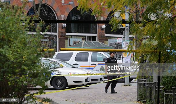 A police officer stands guard near to the National War Memorial site on October 22 2014 in Ottawa Canada Officials are investigating multiple reports...