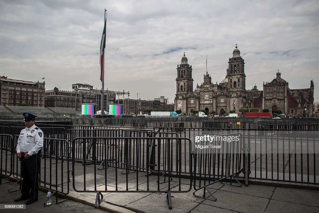 A police officer stands guard, next to fences installed at Zocalo Main Square on February 10, 2016 in Mexico City, Mexico. The Zocalo main square is closed to public, as the perimeter is prepared for the upcoming visit of Pope Francison February 12-17.