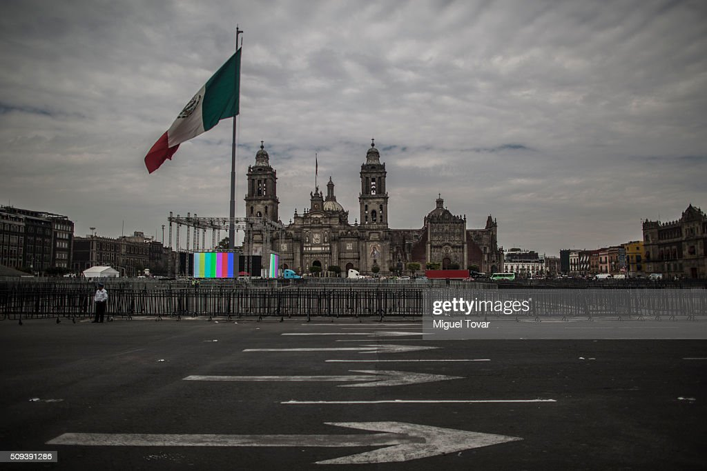 A police officer stands guard, next to fences installed at Zocalo Main Square on February 10, 2016 in Mexico City, Mexico. The Zocalo main square is closed to public, as the perimeter is prepared for the upcoming visit of Pope Francis on February 12-17.