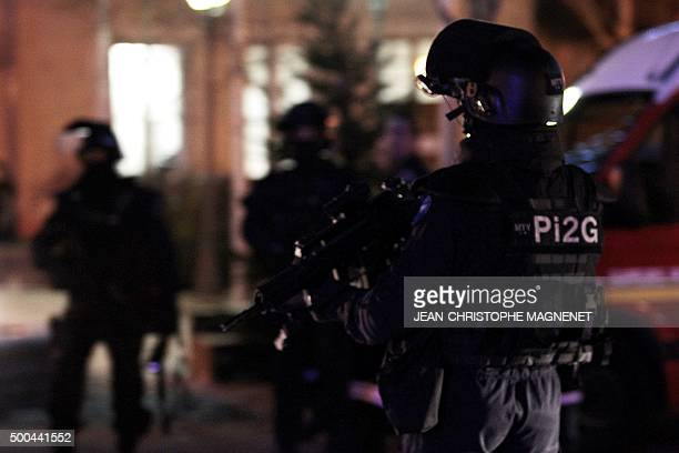 A police officer stands guard on December 8 2015 in La Mole near the city of SaintTropez southeastern France during the search for the murderer of a...