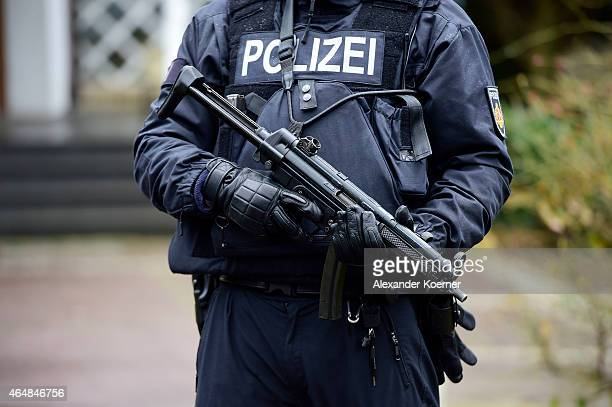Police officer stands guard outside a synagogue on March 1 2015 in Bremen Germany Bremen is on high alert after authorities yesterday reported they...