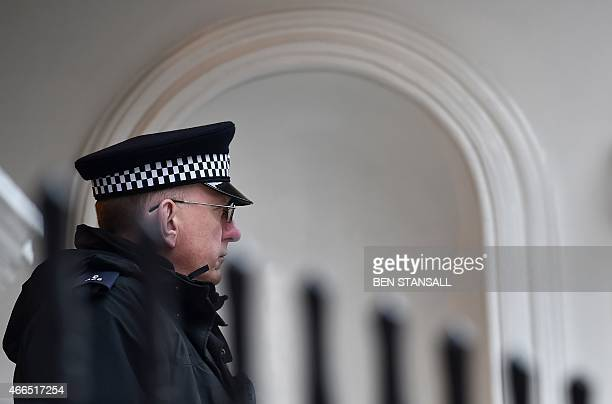 A police officer stands guard outside the Ecuadorian Embassy in London on March 16 where WikiLeaks founder Julian Assange has been living since...
