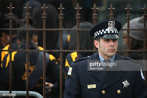 A police officer stands guard outside the Greater Harvest MB Church during the funeral of 15yearold Hadiya Pendleton on February 9 2013 in Chicago...