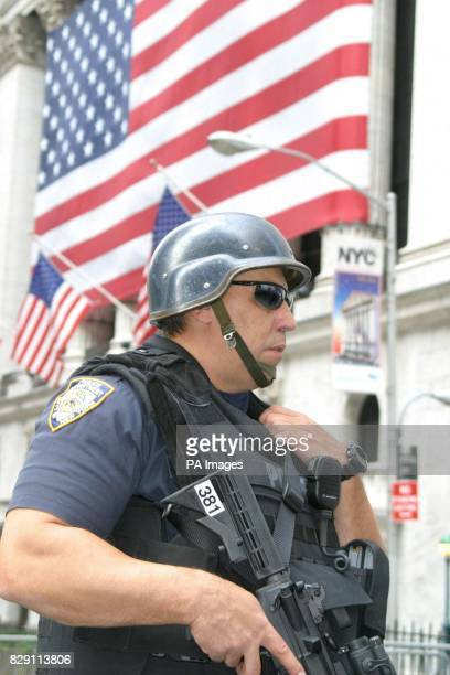 A police officer stands guard outside the Wall Street Stock Exchange in New York a day after US intelligence officials said they had received...