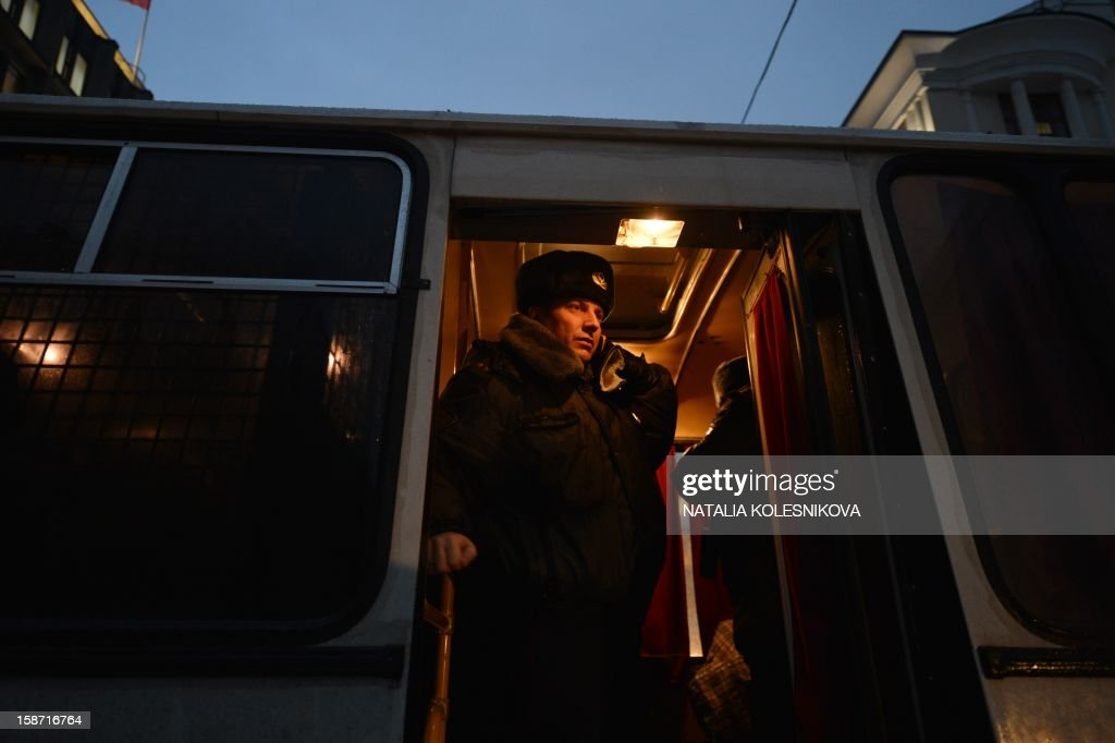 A police officer stands in a bus parked outside the upper house of Russia's parliament, the Federation Council, early on December 26, 2012, ahead of the debate on a bill banning Americans from adopting Russian children. Russian upper house legislators debated today a bill called the Dima Yakovlev bill in memory of a Russian child who died of heat stroke while locked in a car by his adoptive US parent in the summer heat in 2008. Last week Russia's lower house of parliament gave its final approval to the contentious bill that retaliates against a new US human rights measure by barring Americans from adopting the country's children.