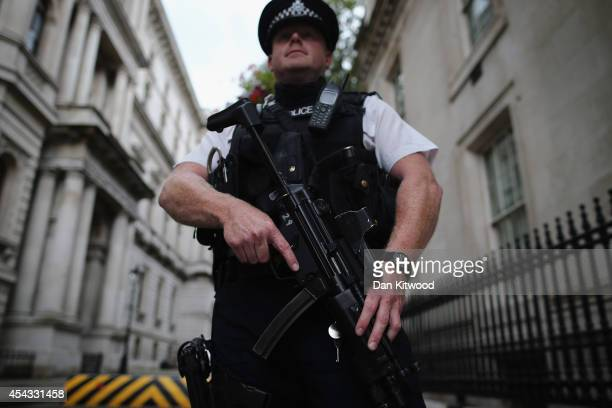 A police officer stands in Downing Street on August 29 2014 in London England British Home Secretary Theresa May announced today that the UK's terror...