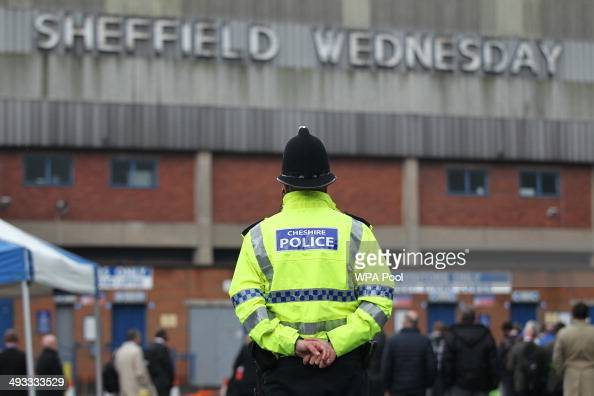 A police officer stands in front of members members of the jury outside the Hillsborough stadium in Sheffield as jurors on the inquest into the...