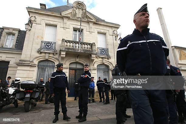 A police officer stands in front of the city hall near to the scene of a bus crash in which at least 42 people were killed after a collision with a...