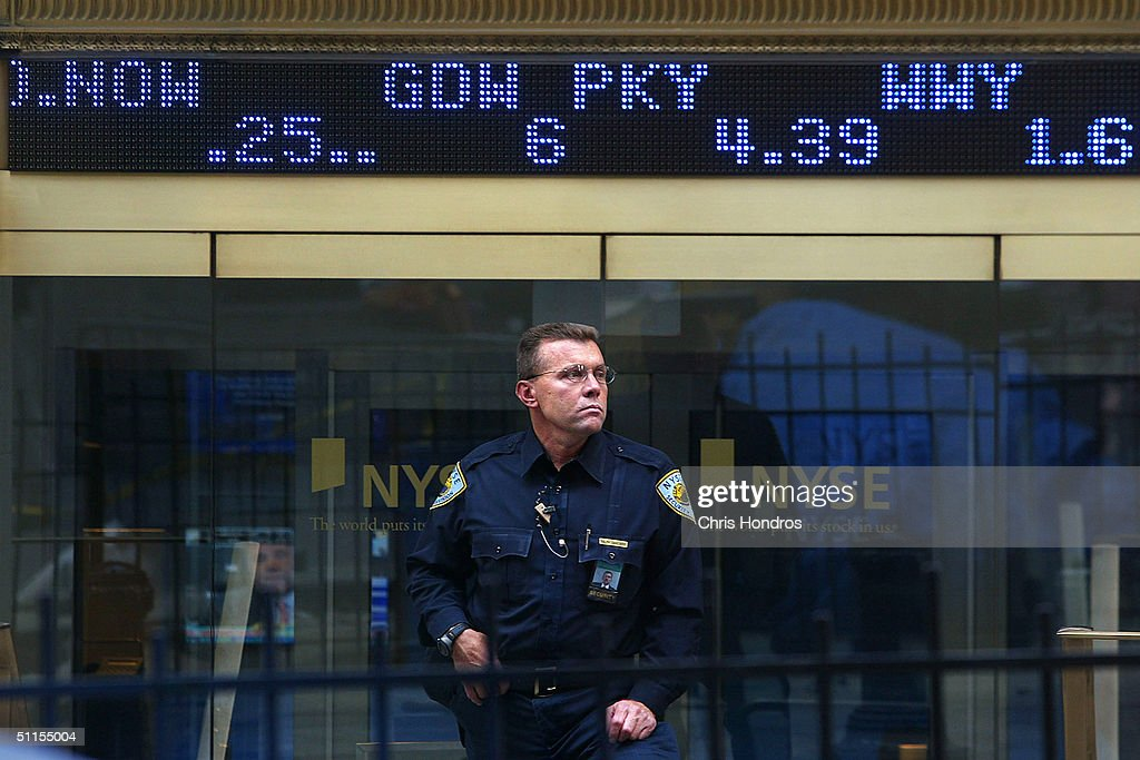 A police officer stands in front of the New York Stock Exchange August 9, 2004 in New York City. Government officials have warned that intelligence points toward terrorists considering using tourist helicopters and Manhattan's ubiquitous limousine cars as possible attack vehicles on the city.