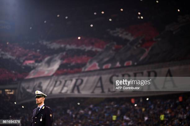 A police officer stands in front of the stands during the Italian Serie A football match Inter Milan Vs AC Milan on October 15 2017 at the 'San Siro...