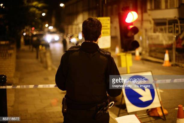 A police officer stands near a police cordon in north London after a teenager was stabbed to death in the latest in a string of youth killings