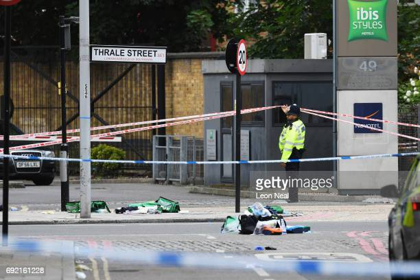 A police officer stands near firstaid debris on Thrale Street on June 4 2017 in London England Police continue to cordon off an area after responding...