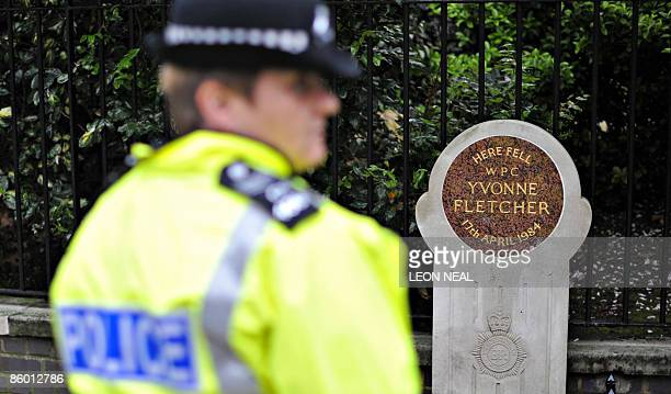 A Police officer stands near the memorial stone to PC Yvonne Fletcher before a ceremony to mark the 25th anniversary of her death in St James Square...