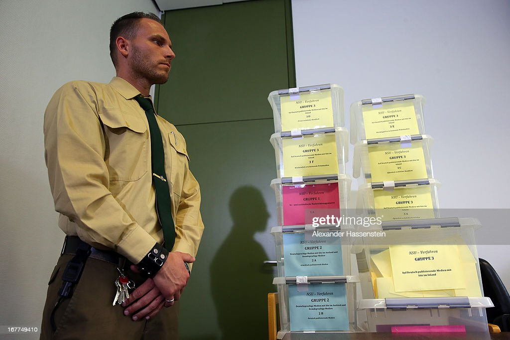 Police officer stands next to a lottery box during the media conference following the lottery draw for the 50 media spots inside the courtroom for the upcoming NSU murder trial on April 29, 2013 in Munich, Germany. This the second accreditation process for the trial, which manay analysts are dubbing the trial of the decade and is scheduled to begin May 6, after lawsuits filed by Turkish media were upheld and the Munich court responded by redoing all accreditations. Eight of the ten victims of the NSU neo-Nazi murder trio were Turkish and one was Greek, and Turkish and Greek media are now guaranteed a small portion of the 50 seats reserved for media after no foreign media were given seats in the first accreditation process.