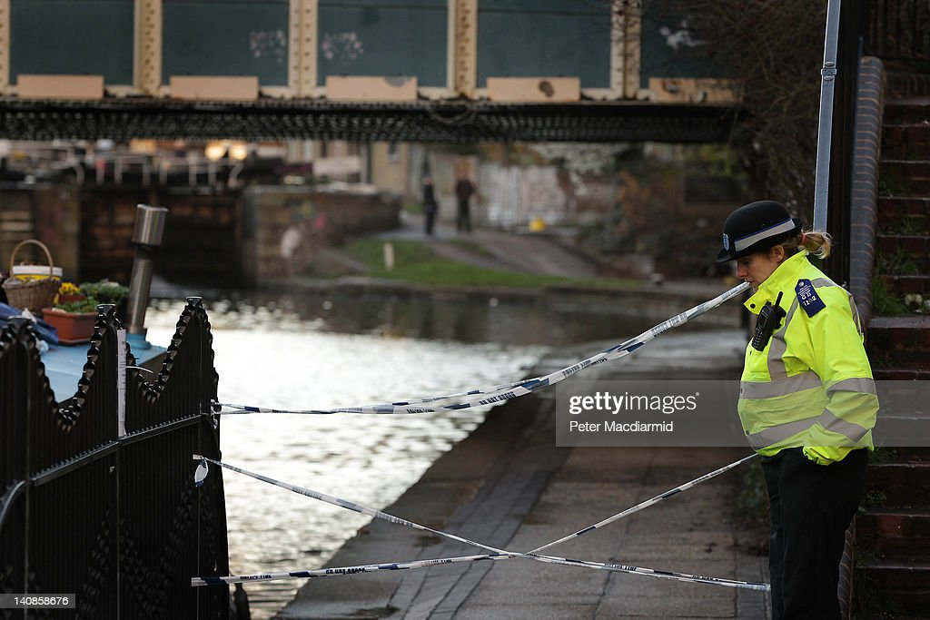 A police officer stands next to an area of Regents Canal in Hackney near where a torso was discovered on March 7 2012 in London England Police have...
