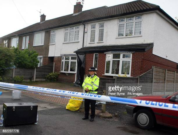 A police officer stands outside a house in Turves Road Cheadle Hulme in Manchester
