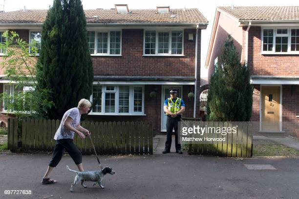 A police officer stands outside a property during a search of a house on Glyn Rhosyn Pentwyn which is believed to be the home of Darren Osborne who...