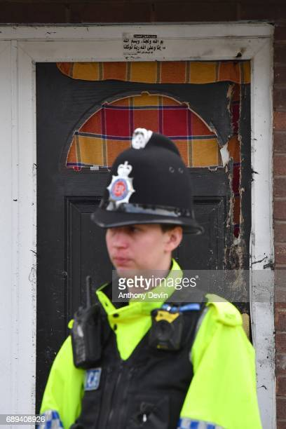 Police officer stands outside a property in Quantock Street in the Moss Side area of Manchester where a raid was carried out earlier on May 28 2017...