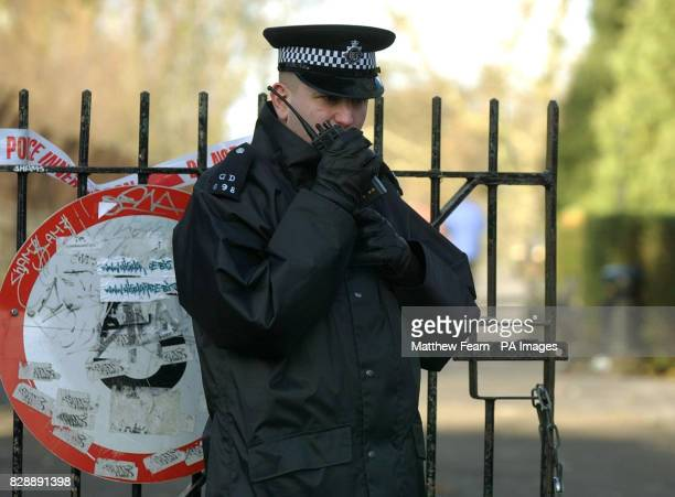 A police officer stands outside a sealedoff Clissold Park in Stoke Newington east London after a jogger was attacked yesterday Detectives believe the...