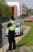 A police officer stands outside Corpus Christi Catholic College in Neville Road Leeds where a female teacher was fatally stabbed on April 28 2014 in...