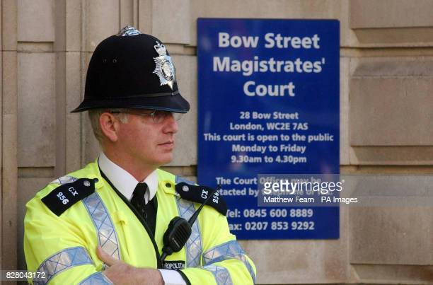 A police officer stands outside London's Bow Street Magistrates Court where Ismael Abdurahman is appearing today