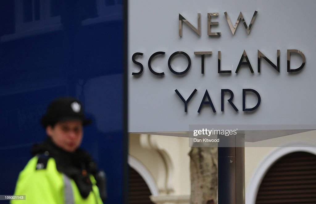 Police officer stands outside New Scotland Yard after a report into the sexual allegations of the late TV star Jimmy Savile was released on January...