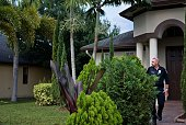 A police officer stands outside the home of Seddique Mateen father of Pulse nightclub shooter Omar Mateen on June 14 2016 in Port St Lucie Florida...