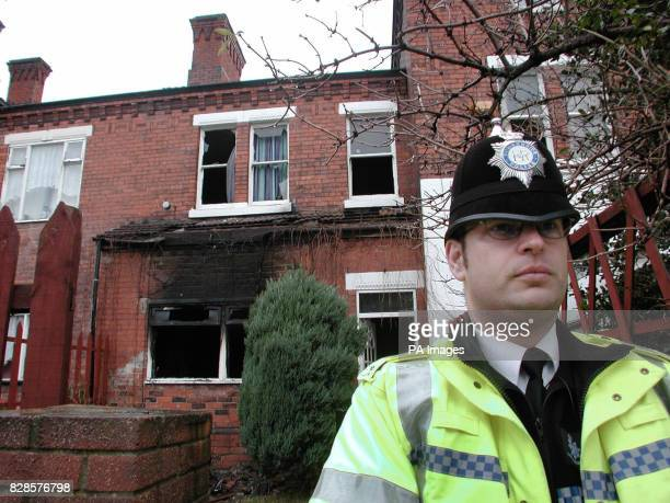 A police officer stands outside the house in Grimsby where a 45 yearold father and his eightyearold daughter died in a house fire * Fire officers...