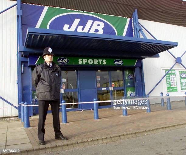 A police officer stands outside the JJB Sports in Alpine Way Beckton east London Police have announced a 36yearold sports shop manager had a gun held...