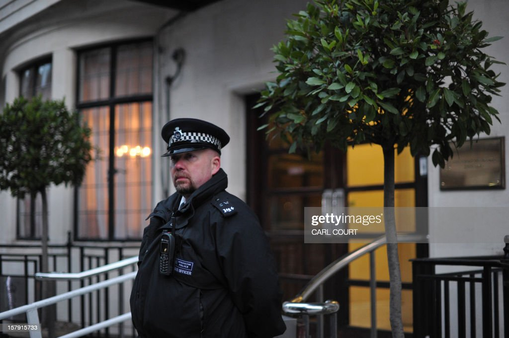 A police officer stands outside the King Edward VII hospital in central London on December 7, 2012 after nurse Jacintha Saldanha was found dead at a property close by. A nurse at the hospital which treated Prince William's pregnant wife Catherine, Duchess of Cambridge, was found dead on December 7, days after being duped by a hoax call from an Australian radio station, the hospital said. Police said they were treating the death, which happened at a property near the hospital, as unexplained. AFP PHOTO / CARL COURT