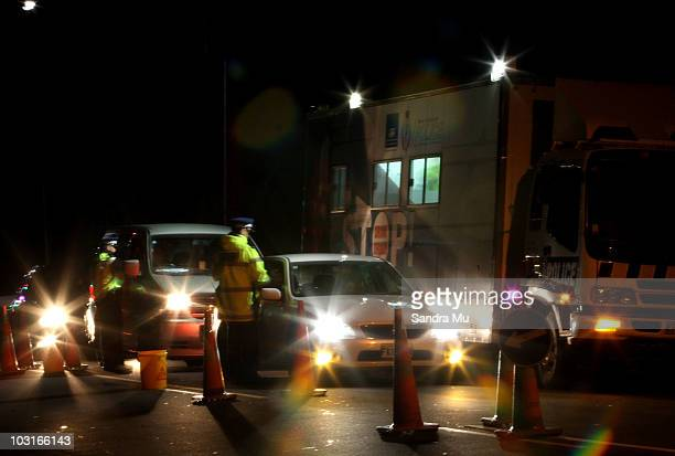 A police officer stops a motorist at a drink driving check point in Penrose on July 30 2010 in Auckland New Zealand The government is implementing a...