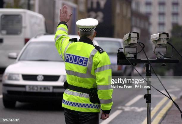 A Police officer stops an unlicensed car on the Old Brompton Road in London The new Stingray camera system shown during a demonstration detect road...