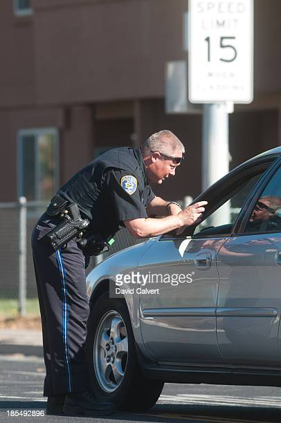 A police officer stops traffic near Agnes Risley Elementary school following a shooting at nearby Sparks Middle School October 21 2013 in Sparks...
