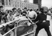 A police officer struggles against a crowd of striking miners outside the Houses of Parliament in London during the miners' strike 7th June 1984 The...