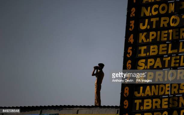 A police officer surveys the crowd during the fifth day of the first test match between India and England at the Sardar Patel Stadium in Ahmedabad...