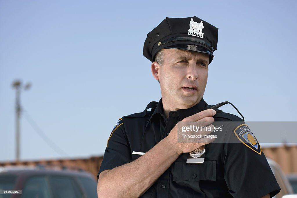 Police officer talking into walkie talkie